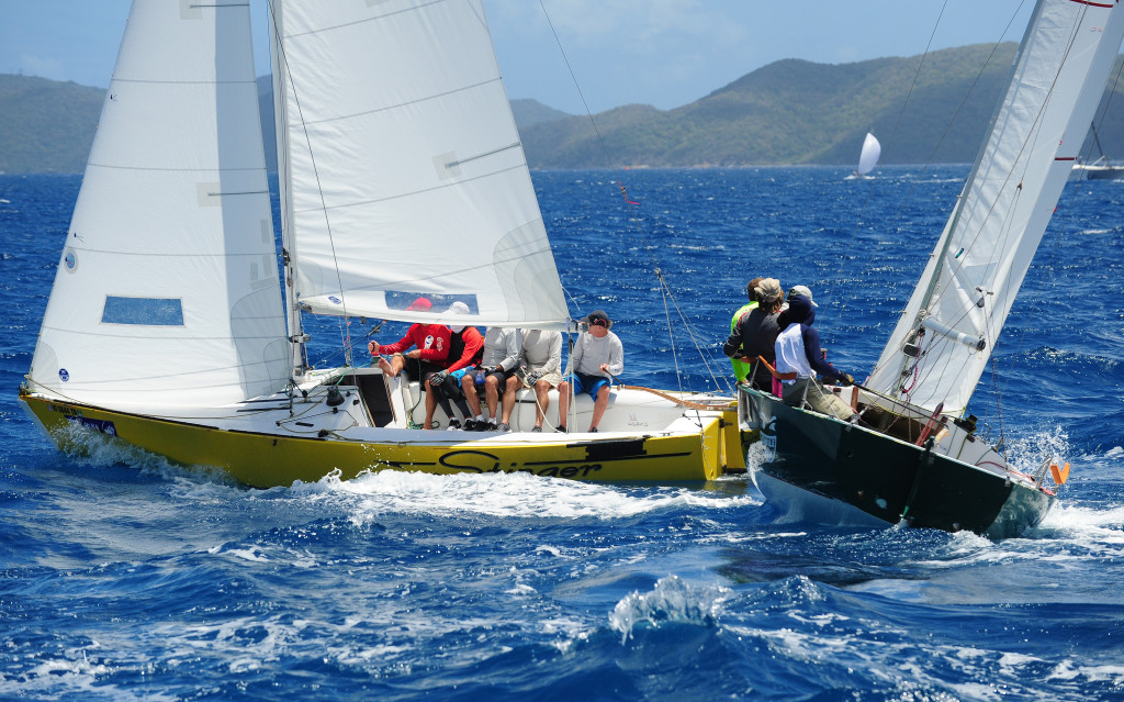ens Hookanson's IC 24, Stinger (ISV) and young sailors from the Royal BVI Yacht Club on IC 24, Black Pearl. The young sailors are all local children and graduates of the KATS (http://www.katsbvi.com/) programme and are 12-14 years old racing in their first regatta! © Todd VanSickle/BVI Spring Regatta