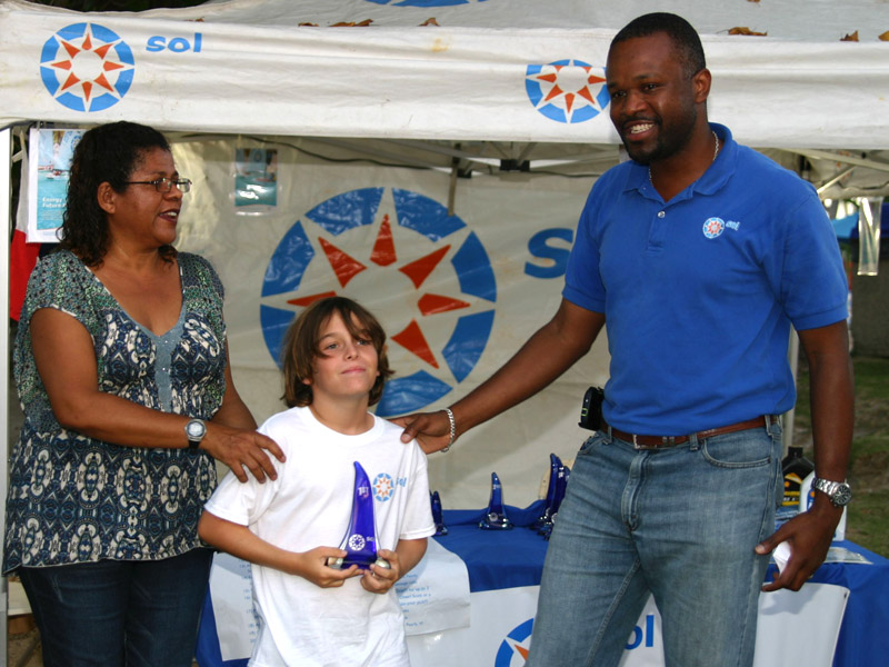 Rayne Duff receives his first place prize from Sol BVI's Chief Operations Manager, Konris Maynard