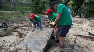 BVI Wombles beach clean digging up